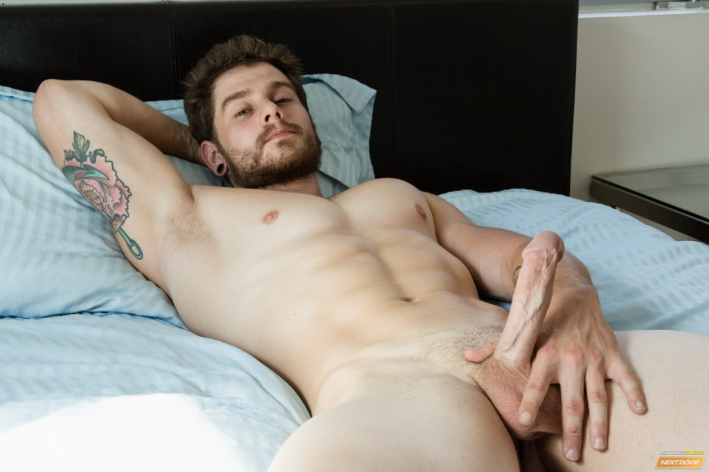 Yummy man licking his bushy feet on the daybed